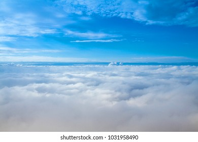 Heaven blue sky with dramatic white clouds background wallpaper