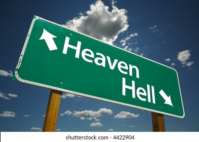 """""""Heaven, Hell"""" Road Sign with dramatic blue sky and clouds."""