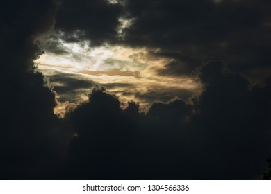 heaven light in dramatic sky with dark cloud