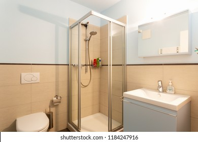Heavenly bathroom with shower and sink, no one inside