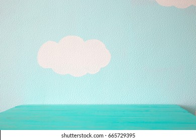 Heavenly blue wall and empty turquoise table