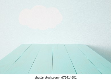 Heavenly blue wall and empty turquoise table.