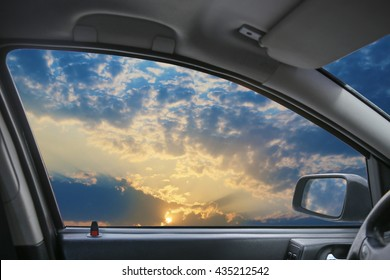 Heavenly landscape behind  car window