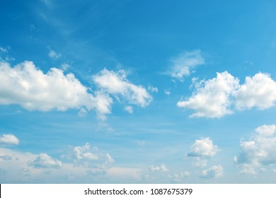 Heavenly landscape - white fluffy clouds in bright blue sky.