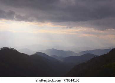 heavenly light with silhouette mountain and cloudy