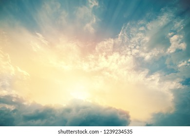 Heavenly view of sun beams lighting turquoise blue sky. For background and wallpaper