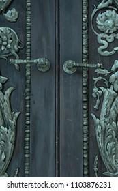 Heavily decorated antique door handles