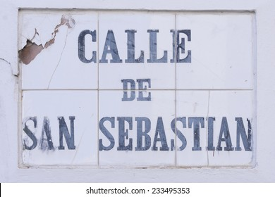 The heavily weather beaten tile street marker identifying Calle de San Sebastian in Old San Juan, Puerto Rico