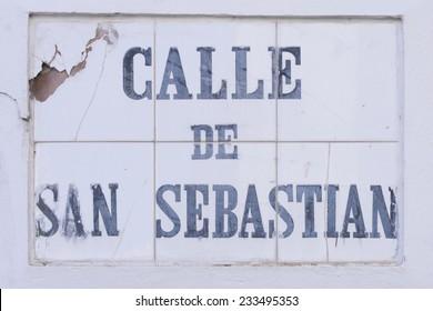The heavily weather beaten tile street marker identifying Calle de San Sebastian in Old San Juan, Puerto Rico
