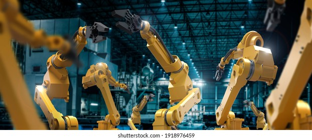 heavy automation robot arm machine in smart factory industrial,Industry 4.0 concept image.  - Shutterstock ID 1918976459