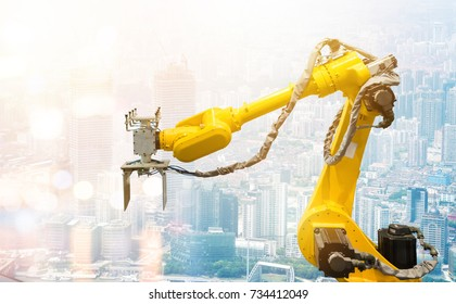 Heavy automation robot arm machine in smart factory industrial. Industry 4th iot and smart logistic , construction  concept with abstract blur bokeh building background. Flare light effect.