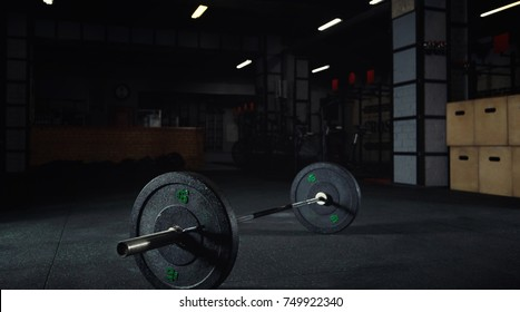 Heavy barbell on the floor of a gym studio copy space bodybuilding weightlifting fitness power strength endurance agility workout exercising interior space box studio sportive lifestyle