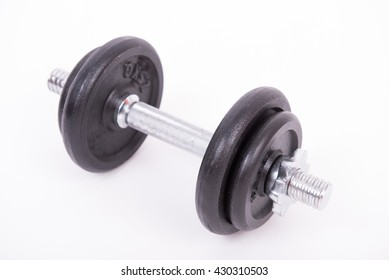 Heavy black and silver dumbbell on white background