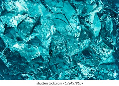 """Heavy bloc of ice in the hall of the """"Ice Hotel"""" in Quebec. Very abstract picture that can serve as an abstract picture. The details are very clear and we can very feel the roughness of the matter."""