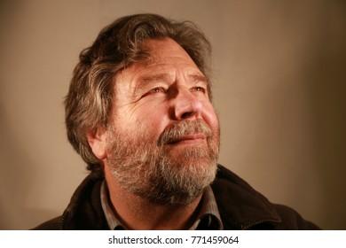 Heavy built 60 year old Bearded man in profile