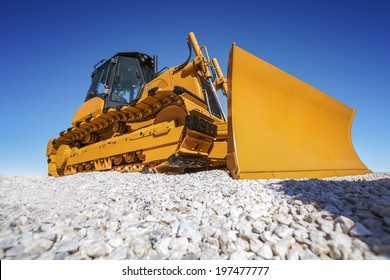 Heavy Bulldozer and deep blue sky