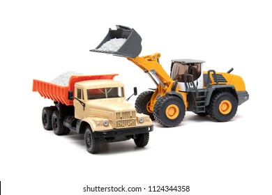 The heavy bulldozer and dump-body truck
