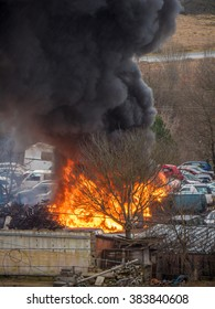 Heavy car fire blazing with black smoke after explosion accident