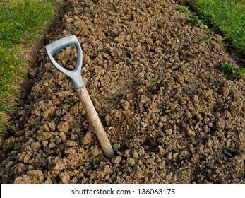Heavy clay soil with buried broken garden fork - gardening problem