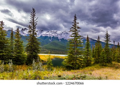 Heavy clouds looming over the valley along the Pocahontas road. Rocky Mountains of Canada.  Concept of active and photo-tourism