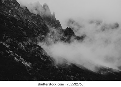 heavy clouds on the sharp Tatra  mountain, black and white with noise