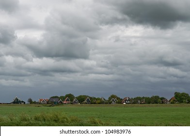 Heavy clouds over a typical Dutch village on a windy day.