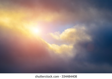 Heavy clouds with sun background.