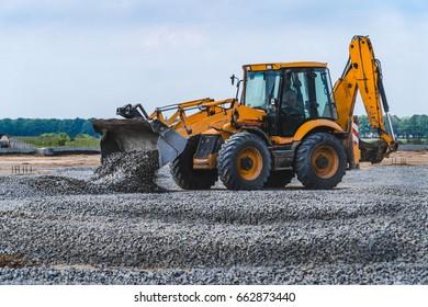 Heavy construction bulldozer of yellow color when building a road.