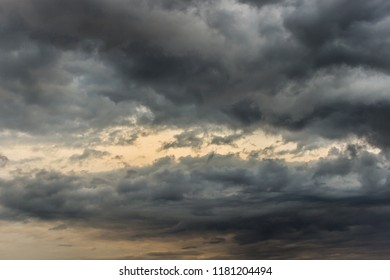 Heavy, dark and moody clouds in the sky. Dramatic, autumn sky.