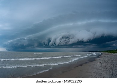 Heavy dark thunderstorm clouds over Lake Erie seascape. Severe weather, hurricane, heavy rain, strong winds, hailstorm concept. Ontario, Canada. HDR landscape image.