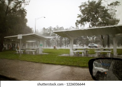 Heavy downpour of rain seen from car interior on an American reststop in Florida.