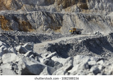 Heavy dump truck in a quarry. Mining industry. Heavy equipment.