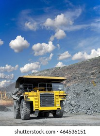 Heavy dump truck transporting iron ore from the opencast