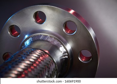 Heavy Duty High Pressure Hose on Stainless Steel Background