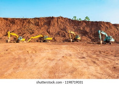 Heavy duty hydraulic crawler excavator on dirt field at a construction site