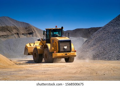 Heavy duty machinery working on highway construction site. Bulldozer, dumper truck, tractor.