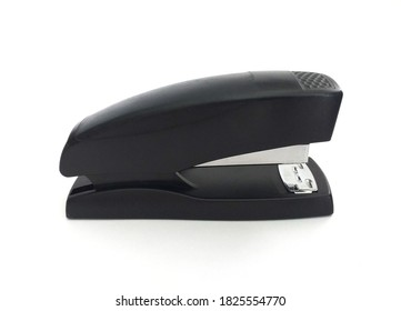 Heavy duty metal black stapler isolated on white background. School and office supplies. Classic black office stapler, close up.