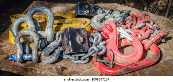 Heavy duty recovery equipment for 4x4 offroad use with chains, shackles and belts outdoors