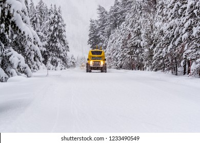 Heavy duty snow bus vehicle plows over snow of Highway 20 in Yel
