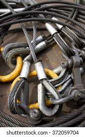 Heavy duty steel wire rope sling with safety anchor shackle bolt in construction site.