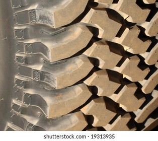 Heavy duty tread on an offroad tire provides interesting contrast and texture in this closeup picture.