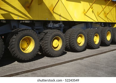 Heavy equipment. Detail of heavy equipment. Part of mobile crane. Wheels in a row
