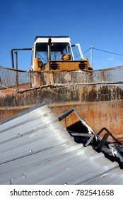 Heavy equipment moving trash at the dump