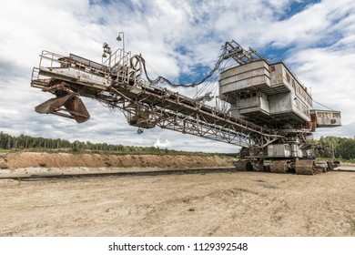 Heavy equipment. Multi bucket excavator, giant stacker, absetzer in career. Giant excavator. Russia
