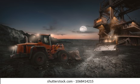 Heavy equipment vehicles of various types - wheeled bulldozer -  in night shift work on a construction site at open pit mine.
