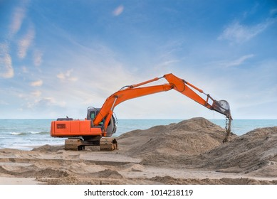 Heavy excavator working construction ground preparation beach on the sea shore, Construction vehicle