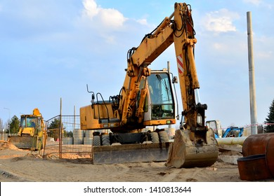 A heavy excavator in a working at construction site. Special heavy construction equipment for road construction.