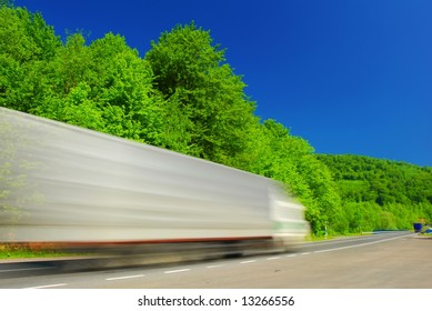 Heavy fast moving truck on the road