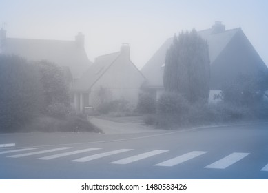 Heavy fog in the town of Perros-Guirec. Vintage style. Brittany. France