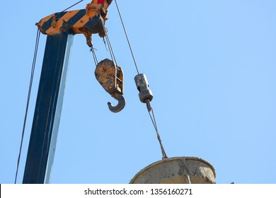 heavy hoist iron hook lifting of machinery crane construction industrial with clear blue sky background